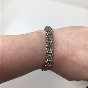 Silver bracelet, silver & gold toned with Aztec